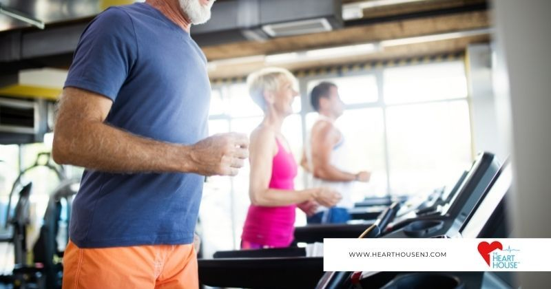 Man jogs on treadmill to improve his blood pressure naturally with exercise as recommended by the Heart House.