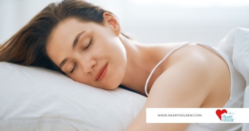 Woman sleeps soundly to benefit her heart health as advised by the Heart House New Jersey.